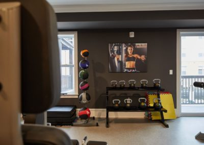 free weights and kettlebells in the fitness center at The Winston at Lyndhurst, NJ