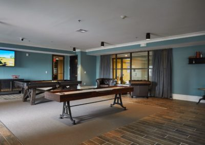 Pool table and shuffleboard in the resident clubhouse at The Winston at Lyndhurst apartments